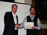Barry Stidham presents the CAE SimuFlite Type Rating Scholarship to Joe Guardiola